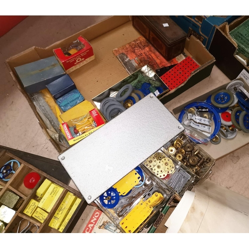 707 - A large collection of Meccano parts, including originally packeted Meccano Extra Parts, Super Tool s...