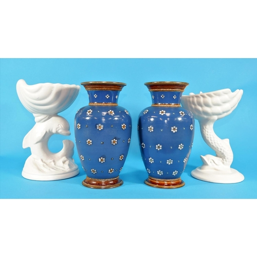156 - A pair of Metlach stoneware baluster vases decorated with flowerheads on a blue ground; 2 white pede...