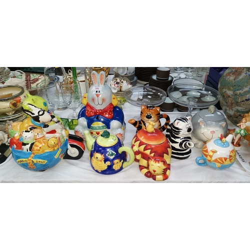 165 - A collection of novelty cookie jars...