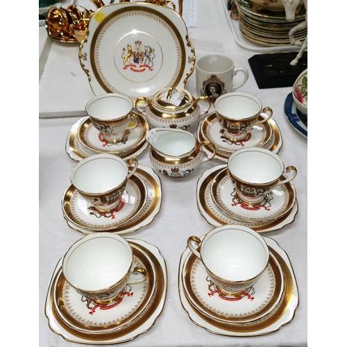168 - A Windsor bone china 21 piece tea set commemorating the Coronation of H.M. Queen Elizabeth II, a sil...