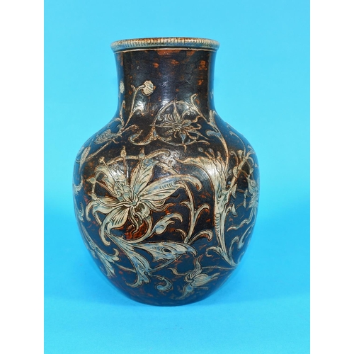169 - A stoneware bulbous vase by Martin Brothers, with incised decoration of scrolling orchids, blue on b...