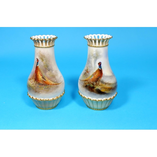 171 - An early 20th century Royal Worcester pair of porcelain vases, with hand painted with polychrome pan...