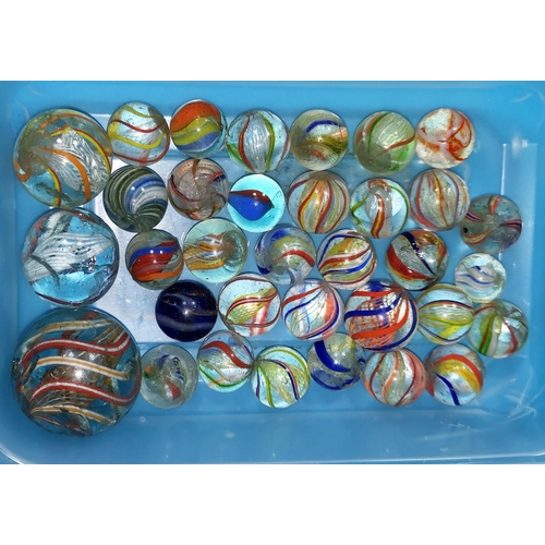 172 - A collection of over 30 19th century colour spiral marbles...
