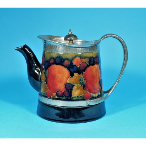 176 - A 1930's Moorcroft pomegranate pattern teapot of tapering cylindrical form, with beaten pewter lid a...