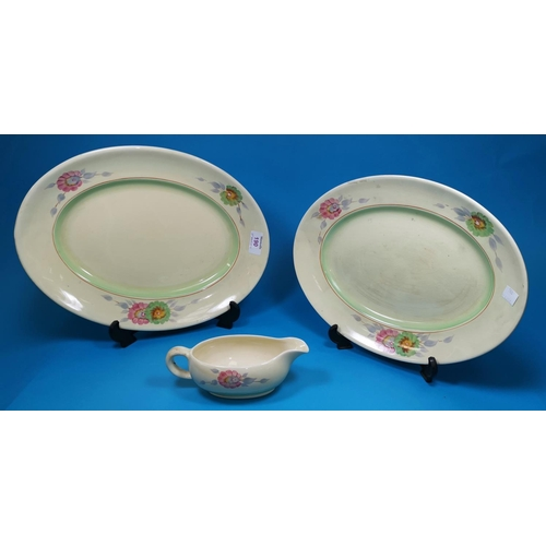 190 - Two oval graduating meat plates and a gravy boat by Clarice Cliff, decorated with poppies (smaller m...