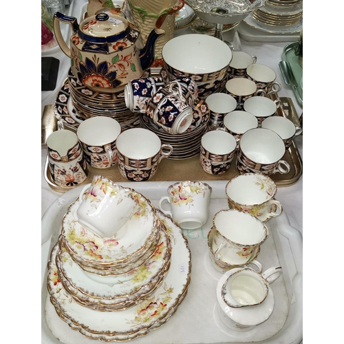 178 - A 19th century Japan pattern part tea set; a floral tea set...