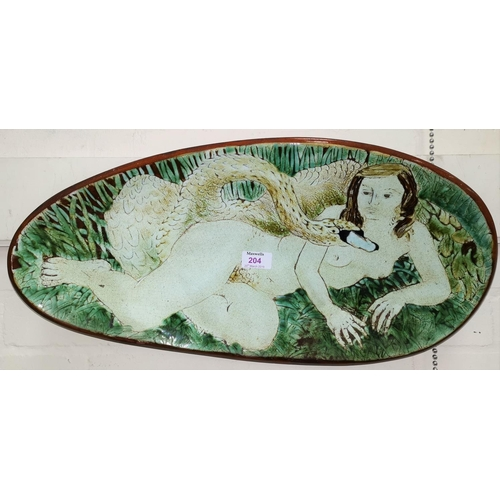 204 - A studio pottery terracotta plaque in oval form depicting Leda and the Swan in crackle glaze length ...