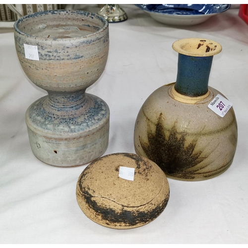207 - Three  studio pottery pieces:  a goblet shaped vase in mottled blue and brown, the base stamped 'PR'...