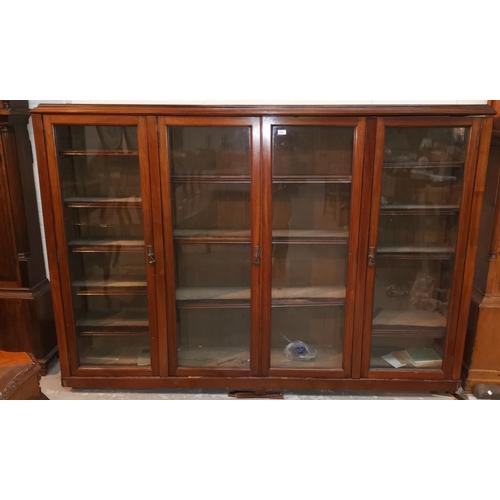 554 - An early 20th century mahogany library bookcase enclosed by 4 glazed doors, 84