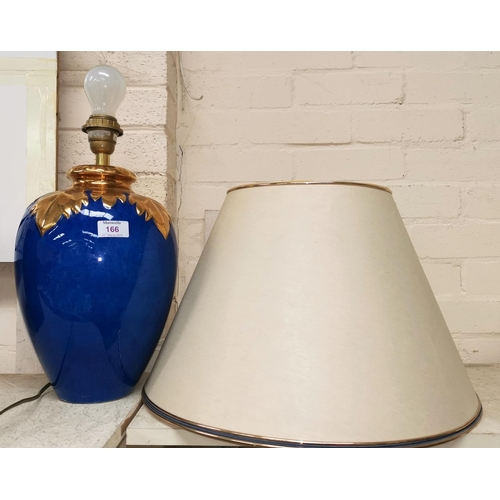 166 - A 1980's ovoid table lamp by Louis Drimmer, in powder blue with raised gilt leaf decoration, with sh...