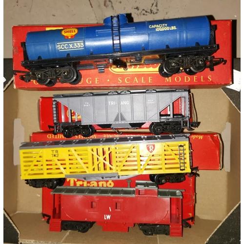 459A - 4 originally boxed Triang 00 wagons R115 Caboose: R126 Stock car: R137 cement car: R117 oil tank bog...