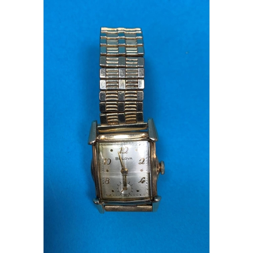 301 - A gent's vintage gold plated Bulova wristwatch with square dial...