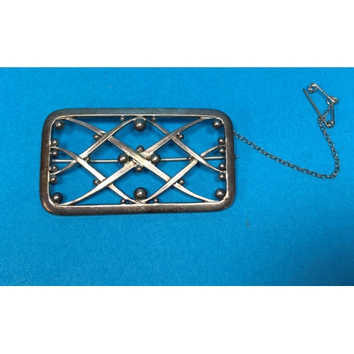 344 - A silver rectangular brooch with ball and lattice work panel, by Georg Jensen, No 266...
