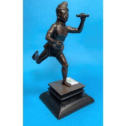 468 - A 20th century Burmese bronze depicting a man in loincloth. on wooden base, stamped 'M G Pozi n Pegu...