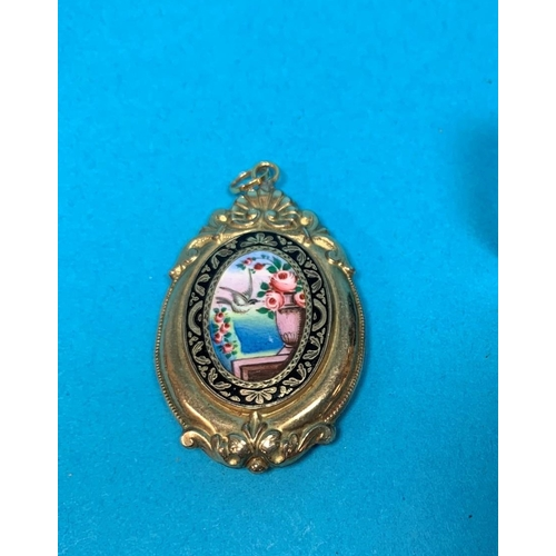 357 - A Victorian gilt metal mourning brooch/locket, decorated in black and coloured enamels with a dove a...