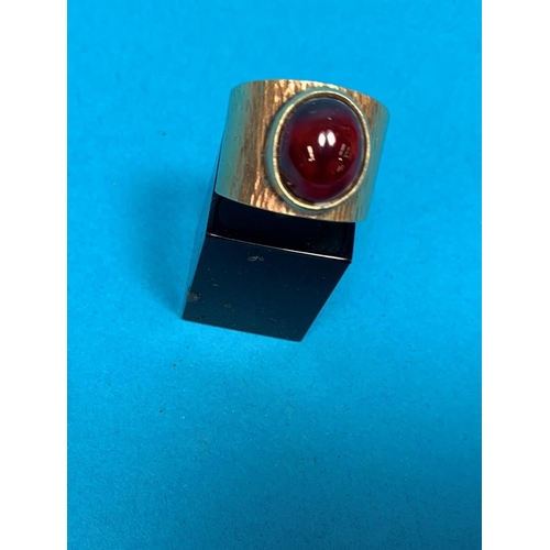 358 - A wide bark effect ring set cabochon garnet, stamped '9CT', 6.8 gm...