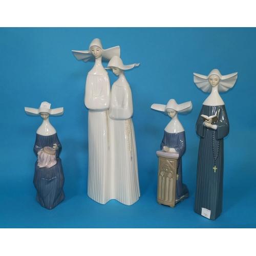 181 - A Lladro tall group of 2 nuns; 3 similar figures...