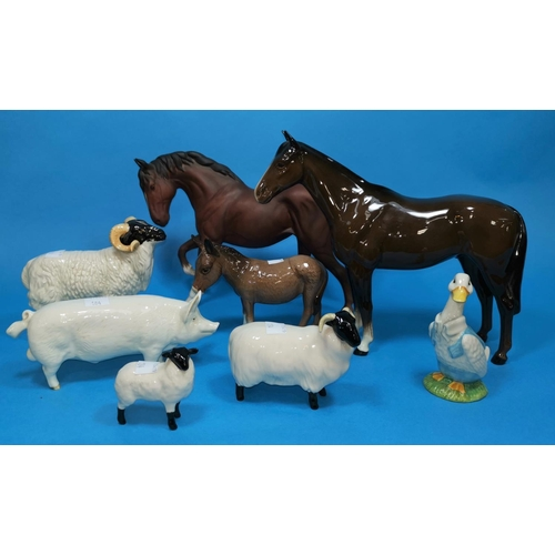 185 - A Beswick figure of a pig C H Wall; 2 Beswick horses and various sheep...