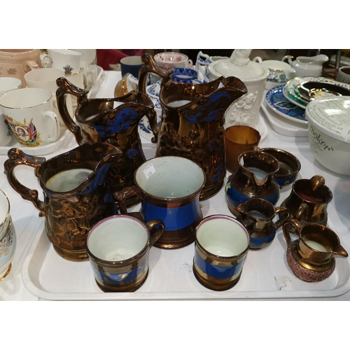 189 - A set of 3 gradating lustre jugs; other lustre ware; a 19th century Bristol blue decanter and wrythe...