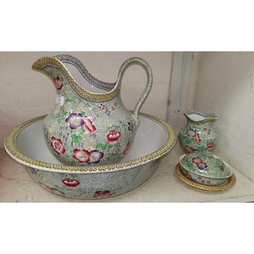 195 - A Cetem ware 4 piece jug and bowl set with floral decoration; 2 Losol ware vases and decorative pott...