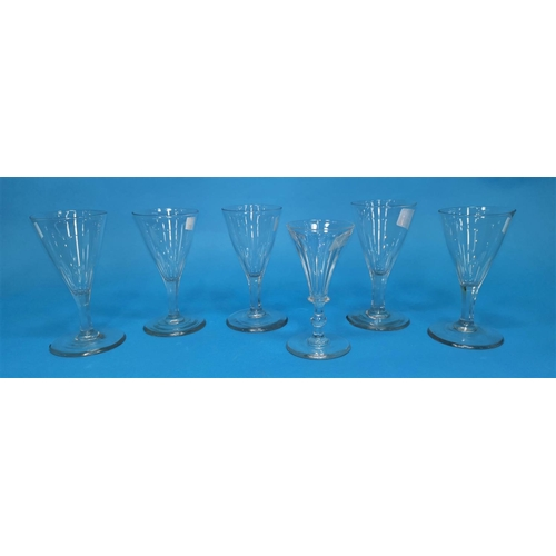 208 - A set of 5 19th century slice cut conical wine glasses with octagonal stems, 13 cm; a similar glass...