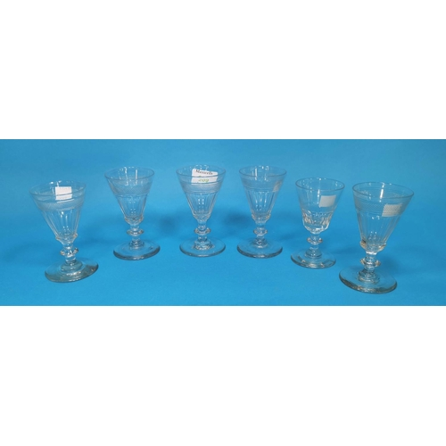 209 - A set of 19th century slice cut wine glasses with diamond cut band, 11 cm; a similar glass...