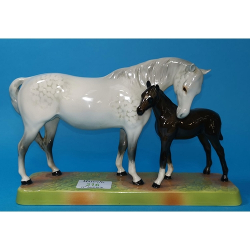 216 - A Beswick china figure of a horse and foal, 9.5