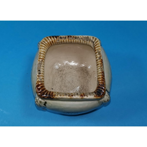 243 - A Martin Bros stoneware open cache pot of square cushion form, decorated in sgraffito with jellyfish...