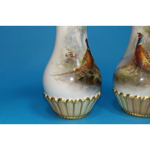 246 - An early 20th century Royal Worcester pair of porcelain vases, with hand painted with polychrome pan...
