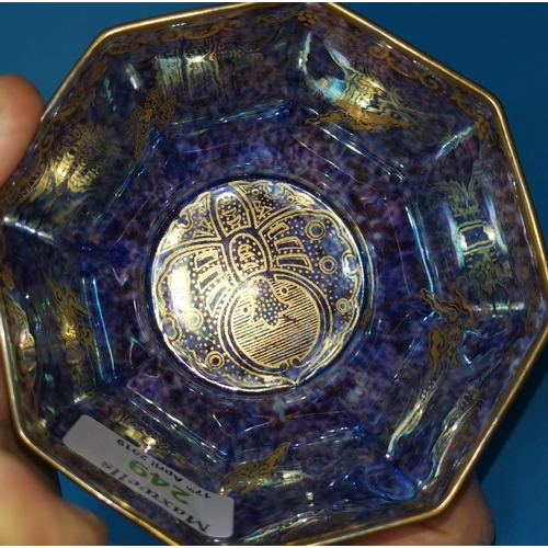 249 - A Daisy Makeig-Jones designed Wedgwood octagonal lustre bowl decorated in gilt with mythical Chinese...