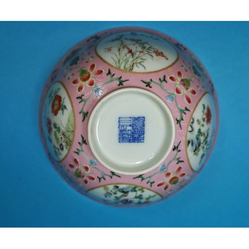 252 - A Chinese porcelain famille rose bowl with floral decoration, decorated with circular panels, blue &...