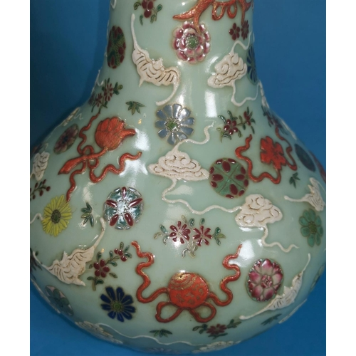 254 - A Chinese celadon baluster vase with painted decoration of clouds, fish, flowers, etc., marks to bas...