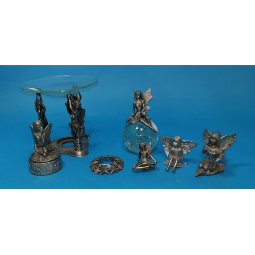 438 - A selection of doll's furniture and china; metal and glass fairies; etc....
