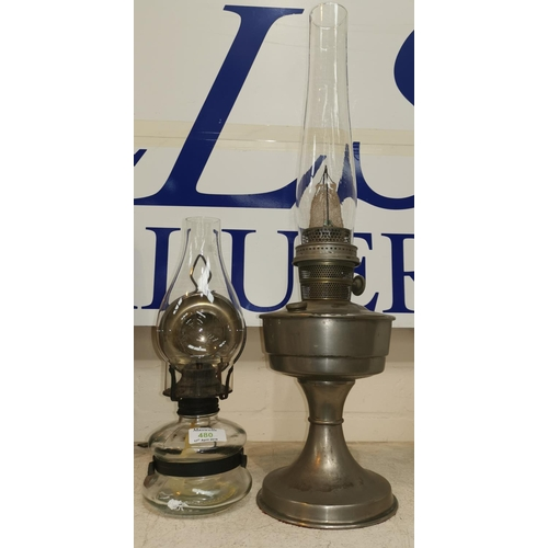 480 - A nickel plated oil lamp; a wall hanging oil lamp with glass reservoir...