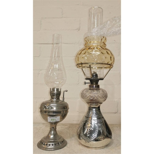 481 - An oil lamp with silver plated bulbous base and cut glass reservoir; a similar lamp made by Little J...