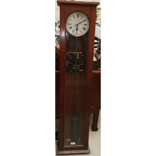 502 - An early mid 20th century oak cased 'Synchrome Electric London' Clock...