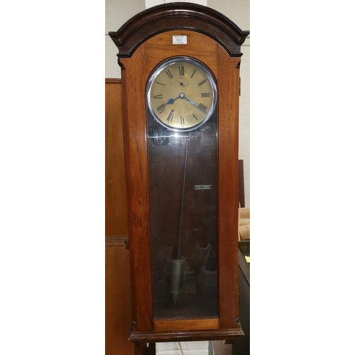 503 - An early mid 20th Century Induction Mahogany cased eletric clock with silvered and brass face height...