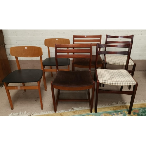633 - A pair of teak dining chairs; a pair of light oak dining chairs and another pair of dining chairs...