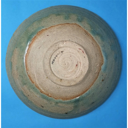 167 - A 1950's studio pottery bowl with blue glaze over incised ground, indistinct seal mark, 9