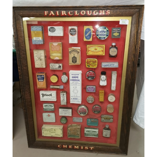 504 - An oak framed display case of vintage chemsit packets, frame lettered 'Fairclough's Chemist'...