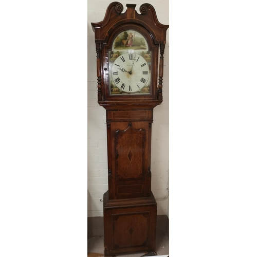 575 - An early 19th century longcase clock in inlaid crossbanded oak, the hood with swan neck pediment and...