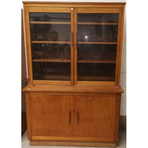 636 - A mid 20th century golden oak bookcase with glazed top above double cupboard, height 71