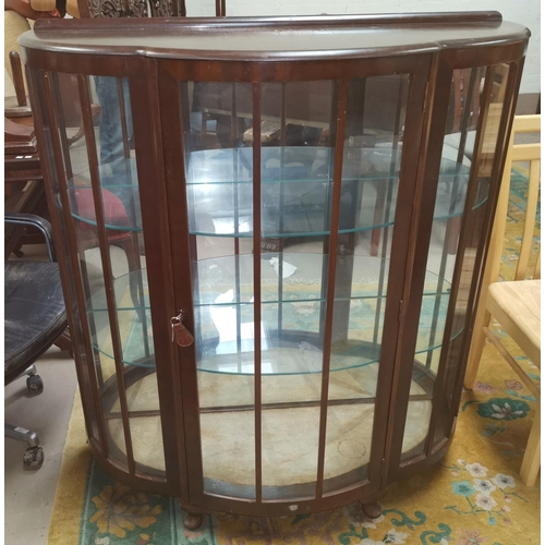 637 - A 1930's oak display cabinet with double leaded glass doors, height 39