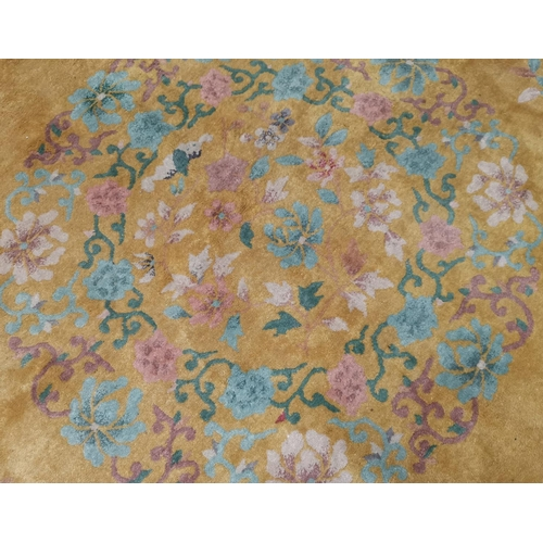 639 - A large Chinese yellow ground carpet, 140