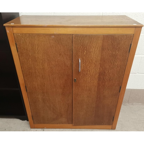 634 - A mid 20th century light oak double cupboard, Height 42