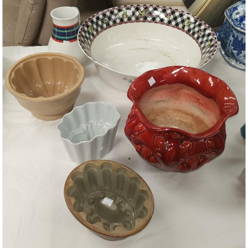 170 - Two stoneware jelly moulds; another; a pottery bowl; etc....