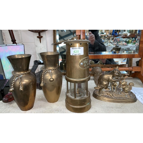 428 - A brass miners' lamp with Cymru plaque; a brass squirrel; 2 vases; a brass firescreen and coal scutt...