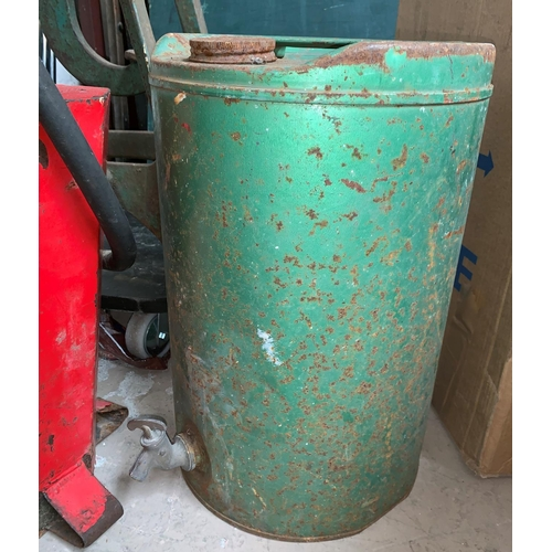 460A - A vintage red painted petrol pump with twin handle and a similar oil...