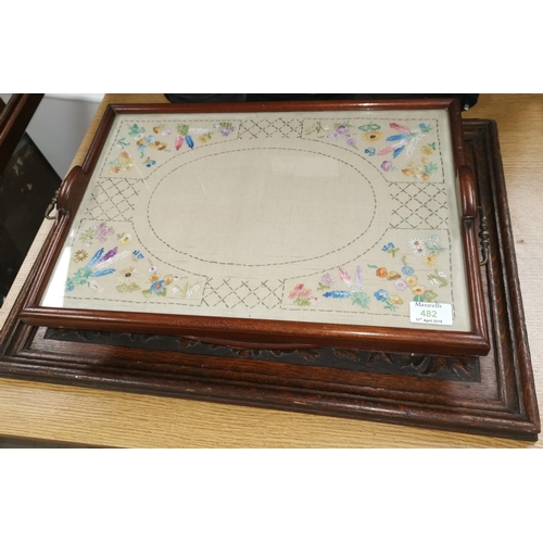 482 - A carved oak rectangular tray; another; 2 inlaid mahogany trays; another with embroidery...