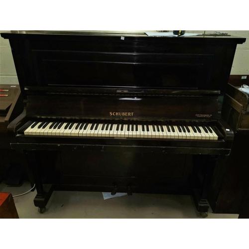 640 - A mahogany cased Shubert upright piano...